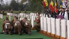 Soldiers lower one of the World War I soldiers into his final resting place