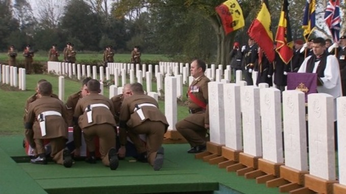 Soldiers lower one of the World War I soldiers into his final resting place. Credit: MoD