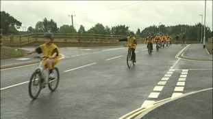 children cycling on Tolvaddon road