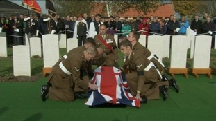 The Union Jack was laid over each coffin during the ceremony at  Commonwealth War Graves Commission Y-Farm Cemetery.