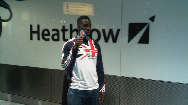 Dwain Chambers displays his bronze medal in Heathrow this evening