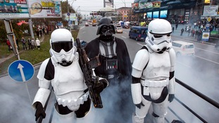 Darth accompanied by two of his stormtroopers campaigning in Kiev.