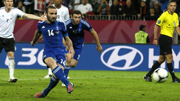 Greece striker Dimitris Salpingidis slots home a penalty.