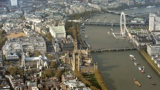 Aerial view of Westminster including Westminster Abbey, Whitehall, Horseguards Parade, the Houses of Parliament and London Eye, London