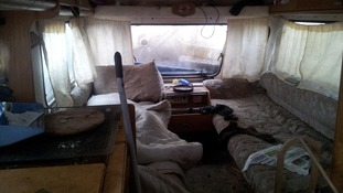 The interior of the caravan where Darrell Simester was forced to sleep