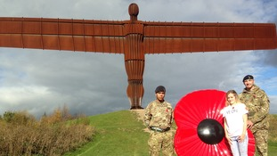 The Angel of the North dons a giant poppy to commemorate the launch of the British Legion's poppy appeal.
