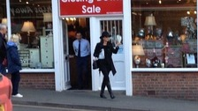 Catherine Zeta Jones walks out of a Whitby shop clutching her bargain