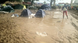 Campers battle through the mud