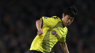 Shinji Kagawa in action for German double winners Borussia Dortmund