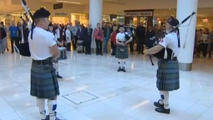 Pipers and drummers took part in a shopping centre flash mob.