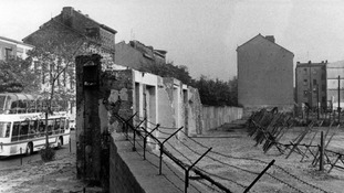 View of the Berlin Wall with separation barriers and death strips in 1965