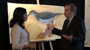 Timothy Spall shows off one of his canvases to ITV News Correspondent Nina Nannar