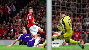 Thibault Courtois saves a shot by Robin Van Persie