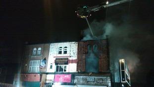 Aerial hose douses fire