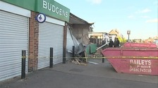 A supermarket has been left severely damaged after thieves drove a digger through the front of the building.