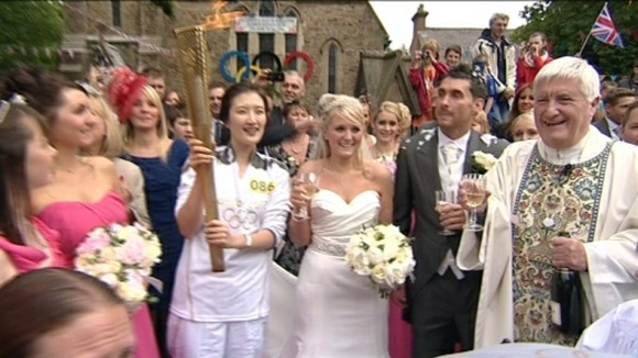 Catherine and Darren - picture with the torch is icing on the cake