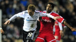 Paul Green faces up against a Reading player at Pride Park