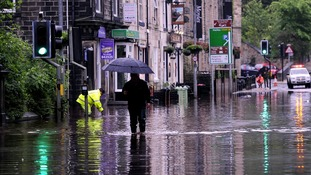 Floodwaters surround local shops in the centre of Hebden Bridge in West Yorkshire.