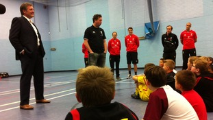 Robbie Fowler speaks to young people at a community group in Liverpool.