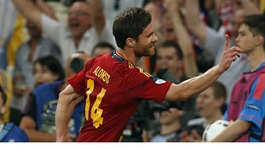 Spain midfielder Xabi Alonso celebrates his first goal.