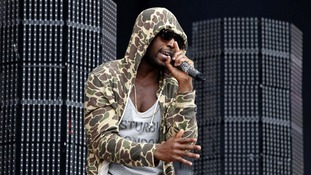 Tinie Tempah performs on the Main Stage at the Isle of Wight Festival.