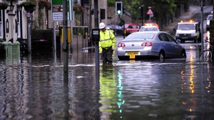 Floodwaters surround local shops in centre of Hebden Bridge, West Yorkshire.