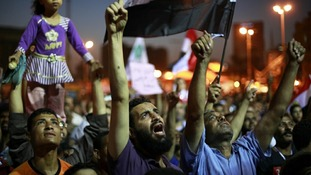 Supporters of the Muslim Brotherhood's presidential candidate Mohamed Morsi shout during a rally against at Tahrir Square