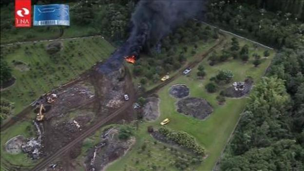 aerial view  lava flow threatens homes in hawaii