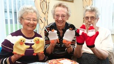 Maureen Robson, Doreen Bell and Maureen Beck model some of their knitted puppets for the children in Newcastle RVI