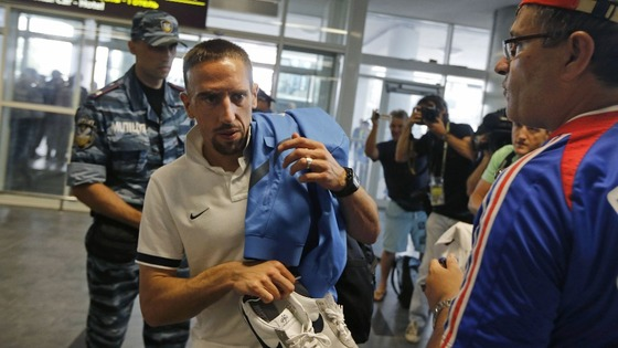 France midfielder Franck Ribery enters Donetsk Airport.