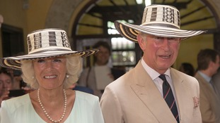 The Prince of Wales and the Duchess of Cornwall don sombreros during a visit to the Museo del Oro