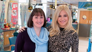 Pixie with Alder Hey's Head of Charities Clare White.
