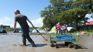 Fans enjoy the festival despite the mud