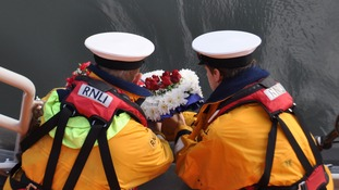 RNLI volunteers lay a wreath for those who died on the Rohilla