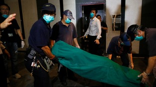 Government workers removed the body of a female found dead at a residential flat at Hong Kong's Wan chai district.