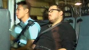 Rurik Jutting arrives at court in Hong Kong.