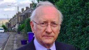South Yorkshire's new Police and Crime Commissioner Dr. Alan Billings arrived for work in Barnsley today - to take up a role he believes should be scrapped.