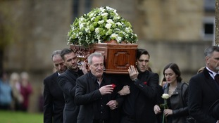 Michael Pattemore (front left), son Robert (front right) and her step-son Bradley (second from left) carry the coffin of Lynda Bellingham into St Bartholomew's Church in Crewkerne, Somerset.