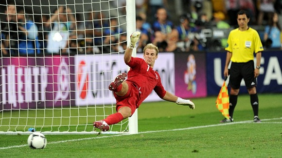 England goalkeeper Joe Hart looks on as a penalty goes in.