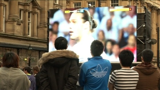 Fans watch football on big screen