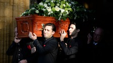 Lynda Bellingham's coffin  is carried out of church by husband Michael Pattemore and sons Robert and Michael.