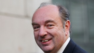 "Norman Baker said working with Theresa May was like ""walking through mud""."