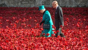 .The Queen and Prince Philip view the ceramic poppies