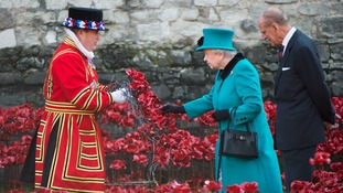 The Queen and Prince Philip view the ceramic poppies
