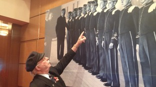 Frank Biggs looking at photo of him displayed on Queen Mary 2