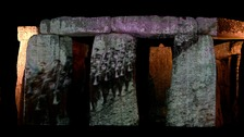 Footage of First World War soldiers marching is projected on to Stonehenge
