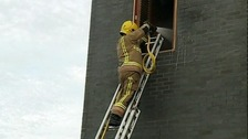 A firefighter from Dorset Fire & Rescue Service in action