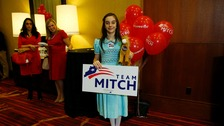 Gabriella Baiano, 10, holds a sign supporting the Senate's new Republican leader Mitch McConnell in Louisville, Kentucky.