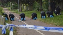 Officers search the crime scene