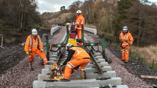The Borders Railway rail installation team in action as the rails cross into the Scottish Borders.